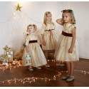 Gold and burgundy velvet christmas party dresses for little girls by French UK designer Little Eglantine smiling