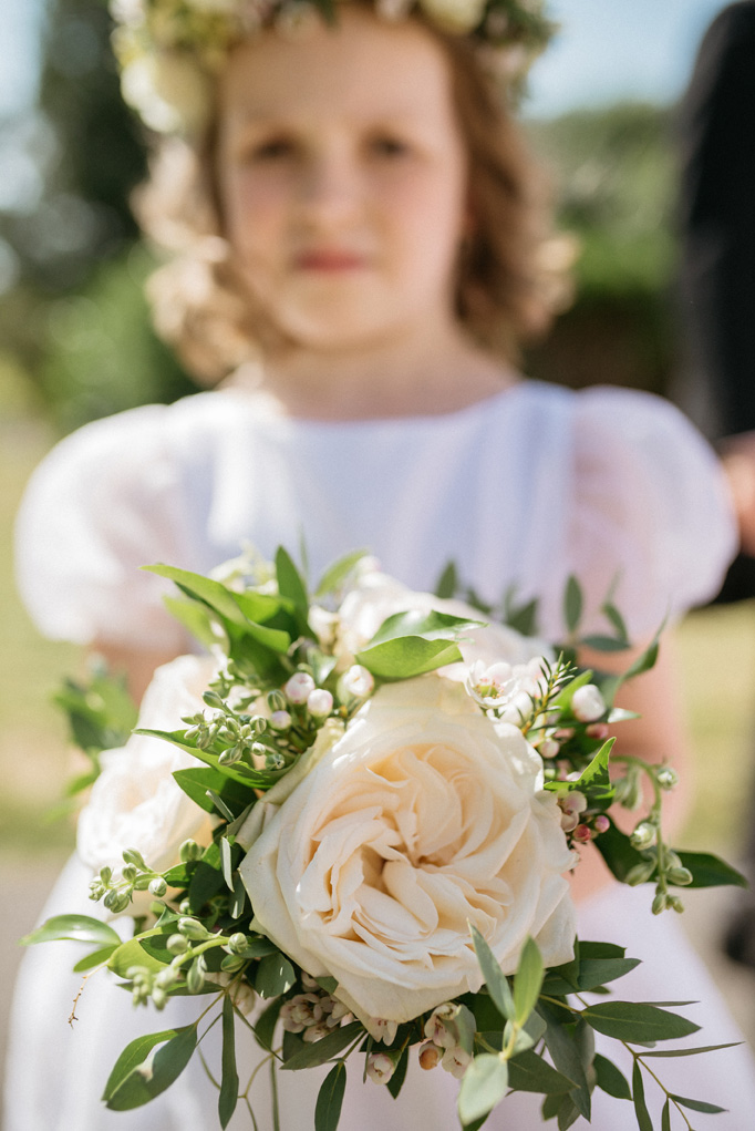 The flower girl is wearing Alix flower girl dress by Little Eglantine