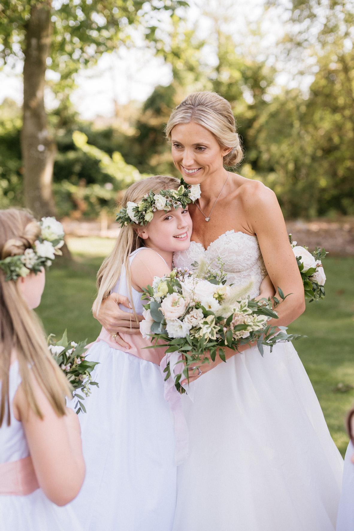 The bride and her flower girls wearing Little Eglantine flower girl dresses