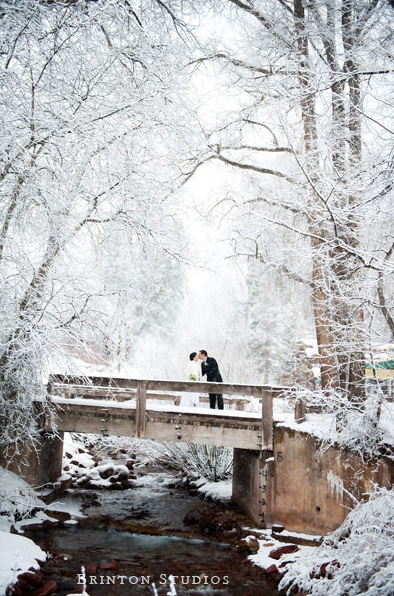 Wedding romance on a bridge during a winter wedding photo Brintonstudios.com