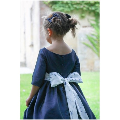 Lovely bow- designer flower girl dress in navy blue for winter weddings by French UK royal designer little eglantine