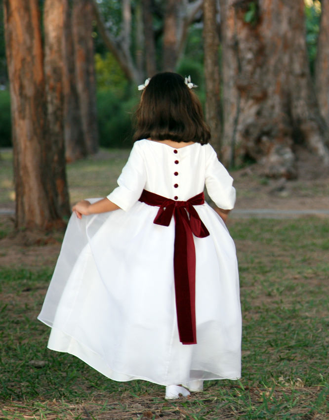 Camill winter flower girl with its lovely deep burgundy velvet ribbon sash