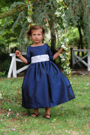 Navy blue winter flower girl dress by French UK designer Little Eglantine