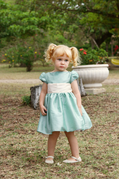 Emilie puff sleeves knee length flower girl dress in sage green with ivory sash by Little Eglantine