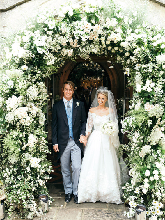 Wedding floral arch by John Carte flowers for Camilla Throp and Georges Blandford wedding at Blenheim palace chapel
