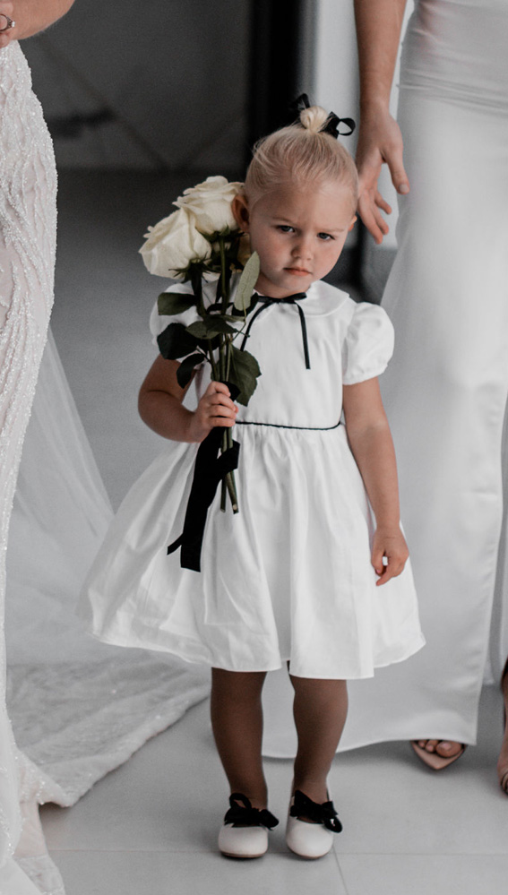 Bespoke black and white flower girl dress by french designer Little Eglantine - puff sleeves and peter pan collar dress