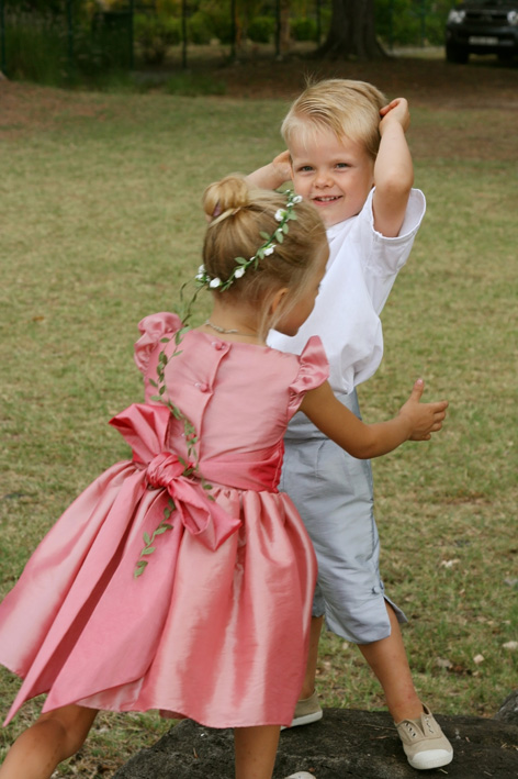 Isabella flower girl dress in pink with grey page boy outfit by designer Little Eglantine