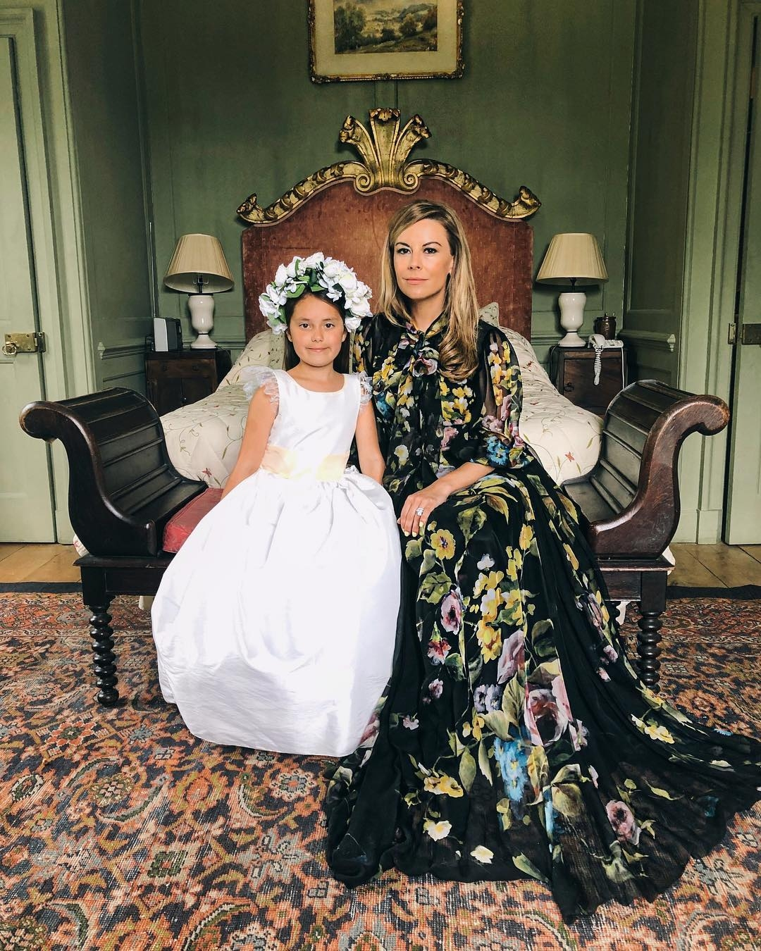 Juliet Angus posing with daughter in Little Eglantine at Millie Mackintosh wedding