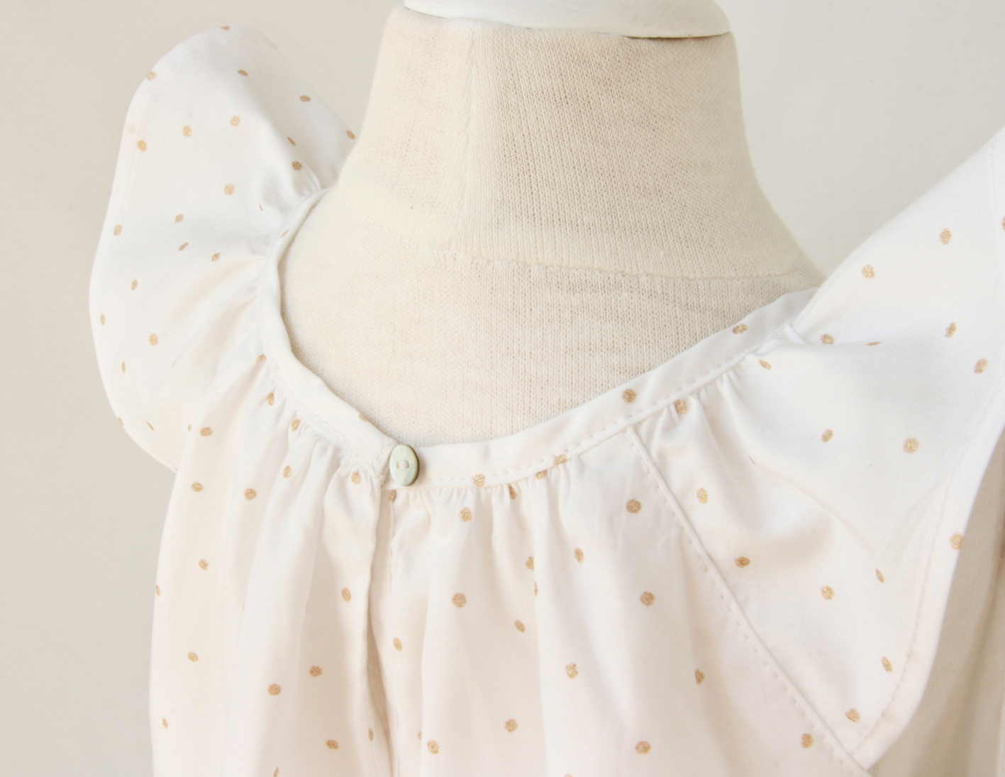 White cotton baby dress with golden dots Little Eglantine