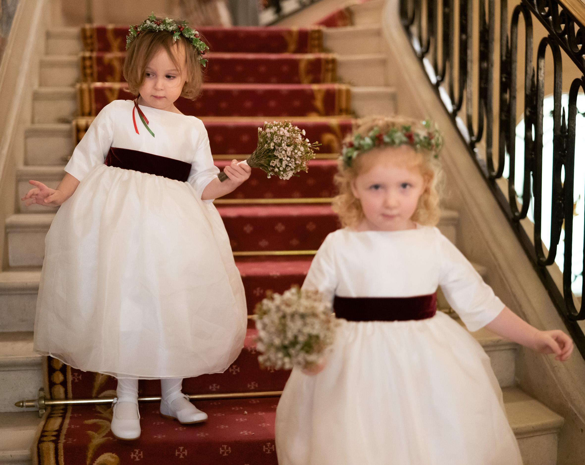 White and burgundy velvet flower girl dresses for winter weddings by French designer Little Eglantine