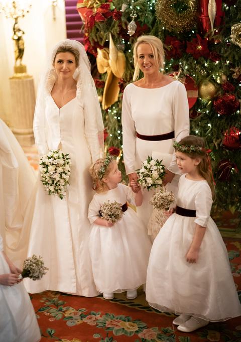 Matching flower girl dresses and bridesmaid dress in white silk organza and burgundy velvet by Little Eglantine