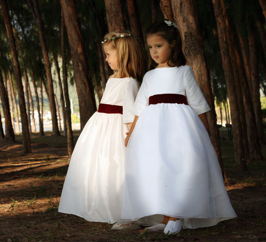 Ines and Camille white flower girl dresses with burgundy velvet ribbon by French designer Little Eglantine
