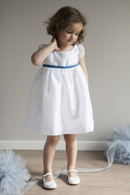 Short designer girls dresses for flower girls and party in white taffeta with pale blue velvet ribbon by designer little eglantine