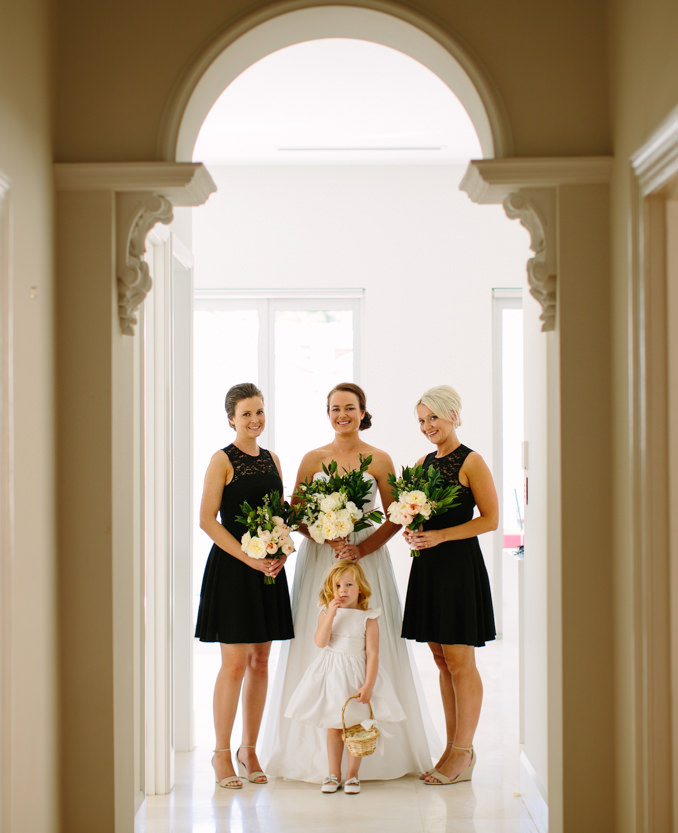 White flower girl dress constrasting with black bridesmaid dresses - Little Eglantine